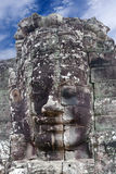 Giant stone face at Prasat Bayon Temple, Cambodia Royalty Free Stock Images