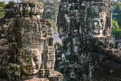 Free Giant Stone Faces At The Bayon Temple In Angkor Wat, Cambodia Stock Photos - 156045883