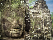 Giant Stone Faces at Bayon Temple in Angkor, Cambodia Stock Photos