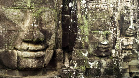 Giant Stone Faces at Bayon Temple at Angkor, Cambodia Royalty Free Stock Photography