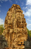 Giant stone faces at Bayon Temple in Cambodia Royalty Free Stock Photo