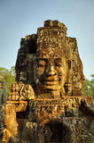 Giant stone faces at Bayon Temple in Cambodia Royalty Free Stock Image