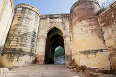 Giant stone fortress gates deserted in the morning Royalty Free Stock Photography