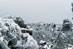 Giant stone rocks above the winter forest on the high plateau royalty free stock image