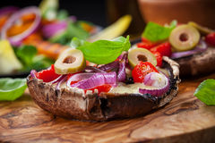 Giant stuffed Portobello mushrooms Stock Photo