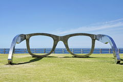 40d3972f076 Giant sunglasses - metal sculpture. Giant sunglasses in a park setting  royalty free stock photo