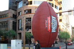 Giant Super Bowl Football. Phoenix, AZ, USA - November 11, 2014: A replica of a super bowl football was mounted downtown Phoenix ahead of the upcoming game. The stock photography