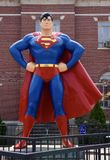 Giant Superman Statue. This is a Summer picture of the Giant Superman Statue  on `Superman Square` located in Metropolis, Illinois in Massachusetts County.  In Stock Photography
