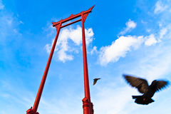 Giant Swing with flying pigeon Stock Image