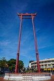 Giant Swing. The Giant Swing is a religious structure in Bangkok, Thailand, Phra Nakhon district, located in front of Wat Suthat temple Stock Image