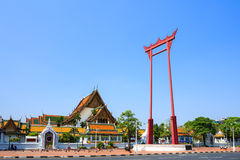 The giant swing (Sao Ching Cha) and Wat Suthat temple Royalty Free Stock Photography