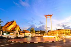 The Giant Swing and Suthat temple at twilight in Bangkok, Thailand Royalty Free Stock Photography