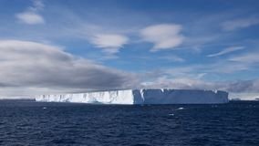 Giant Table Iceberg floating in Antarctic Ocean. Many giant table icebergs were found floating in Antarctic Ocean Royalty Free Stock Photo