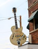 Giant Tan Gibson Guitar in Midtown Memphis, Tennessee. Gibson Guitar Corporation is an American maker of guitars and other instruments, now based in Nashville Stock Image