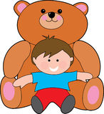 Giant teddy. Bear with a small boy Stock Photography