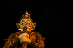 Giant at Temple of The Emerald Buddha. Giant God at The Grand Palace Royalty Free Stock Photography