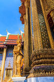 The giant temple guard. Giant Buddha, adorned with many beautiful stained glass , beautiful favorite of tourists in Thailand , Wat Phra Kaew royalty free stock image