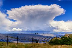 Giant thunderstorm cloud above solar power plant in Provance, Fr. Ance. Power of nature stock photos