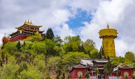 Giant tibetan prayer wheel and Zhongdian temple - Yunnan privince, China Stock Photos