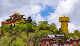 Giant tibetan prayer wheel and Zhongdian temple - Yunnan privince, China. Giant tibetan prayer wheel and Zhongdian temple in Shangri-la - Yunnan province, China stock photos