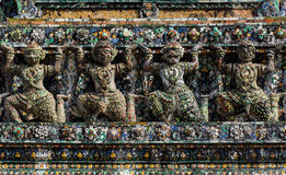 Giant, Titan Statue  at Wat Arun  in Thailand. Stock Photos