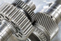 Giant titanium gear machinery. Gears of titanium, mirrored in brushed aluminum, aerospace parts Royalty Free Stock Images