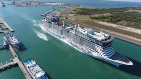 Giant tourist luxury cruise ship boat sailing slowly in calm ocean water in city harbor port in 4k aerial drone seascape. Giant tourist luxury cruise ship boat stock video