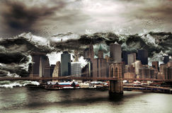 Giant tsunami. On Manhattan. An enormous wave breaks on the city Royalty Free Stock Photos