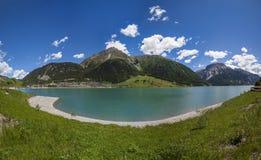 Giant. View of the Resia lake, Resia, Italy Royalty Free Stock Photos