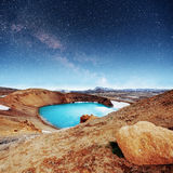 Giant volcano overlooks. Turquoise provides a warm geothermal. Water. Fantastic Milky Way. Meteor shower Iceland stock photo