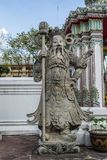 Giant Wat Pho in Bangkok Thailand. Giant is in Wat Pho that is a sculpture at the entrance to the temple or the tetrahedron. In the literature of Ramayana Stock Photo