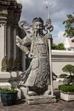 Giant Wat Pho in Bangkok Thailand. Giant Wat Pho Is a sculpture at the entrance to the temple or the tetrahedron. In the literature of Ramayana Royalty Free Stock Photography