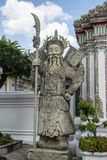 Giant Wat Pho in Bangkok Thailand. Giant is in Wat Pho that is a sculpture at the entrance to the temple or the tetrahedron. In the literature of Ramayana Royalty Free Stock Image