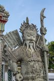 Giant Wat Pho in Bangkok Thailand. Giant is in Wat Pho that is a sculpture at the entrance to the temple or the tetrahedron. In the literature of Ramayana Royalty Free Stock Photo