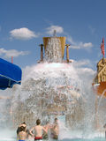 Giant Water Bucket Spills KERSPLASH!. Giant water bucket tips and spills onto boys and girls of all ages at modern community water park Stock Image