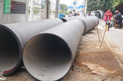 Giant water pipes under the pavement Royalty Free Stock Photos