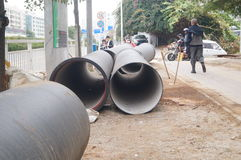 Giant water pipes under the pavement Royalty Free Stock Images