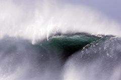 Giant Wave. Storm Surf, Hawaii, North shore, sea spray, Back lit Wave, danger, fury, tropical, high energy Stock Images