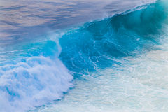 Giant wave in beautiful emerald light Stock Photo