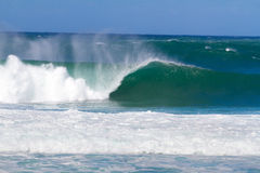 Giant Wave Break in Hawaii. Large waves break off the north shore of oahu hawaii during a great time for surfers surfing. These waves have hollow barrells and Stock Photo