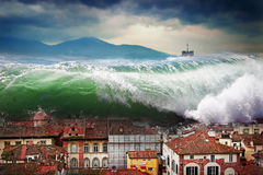 Giant wave crashing above the city Stock Images