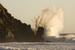 Giant Wave Crashing on Rocky Coast Royalty Free Stock Photos