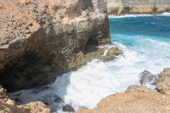 Giant wave filling the cave with seawater at Porte d `Enfer du Moule, Guadeloupe Stock Images