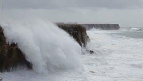Giant Hercules waves break over the shore in Sagres. Costa Visentina. stock video footage