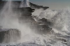 Giant storm seas crash into cliffs Royalty Free Stock Photos