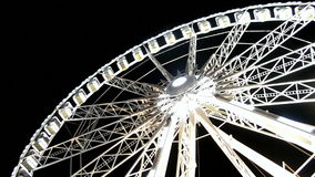 Giant wheel attraction in Paris on black sky, stock footage
