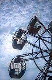 Giant Wheel and cloudy sky Stock Images