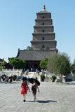 Giant Wild Goose Pagoda. Xi`an, China - May 25, 2017: Two women under umbrellas visiting the main attraction of the city - old Giant Wild Goose Pagoda Stock Photo