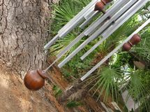 Giant Wind Chimes. Against house with garden Stock Photography