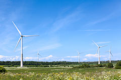 Giant wind energy devices are on the summer field in Europe, renewable energy. Giant wind energy devices are on the summer field in Europe royalty free stock photography